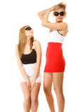 Two crazy women in summer clothes sunglasses. Royalty Free Stock Photo