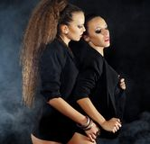 Two sexy dancing woman in black lingerie Stock Photography