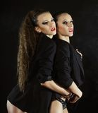 Two sexy dancing woman in black lingerie Royalty Free Stock Photography