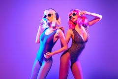 Two DJ girl with Dyed Hair dance. Art music stock photography