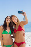 Two friends taking pictures of themselves Royalty Free Stock Photos