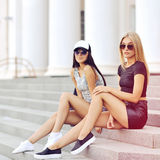 Two sexy girlfriend outdoor fashion portrait.  Royalty Free Stock Photos