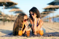 Sexy girls having fun on a beach. Two sexy girls drinking cocktails and taking selfie on a beach Stock Photography