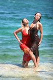 Two girls getting wet in water Royalty Free Stock Image