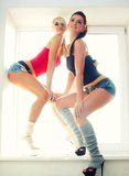 Two sexy girls sports Stock Photos