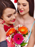 Two lesbian women with flower. royalty free stock photos