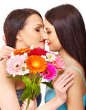 Two sexy lesbian women with flower. Royalty Free Stock Image