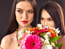 Two sexy lesbian women with flower. Pink background Stock Photos