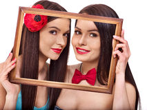 Two sexy lesbian women kissing in art frame. Isolated Royalty Free Stock Images