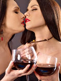 Two sexy lesbian women with red wine. Stock Photo