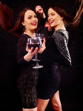 Two sexy lesbian women with red wine Royalty Free Stock Images