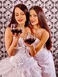 Two sexy lesbian women with red wine Stock Images