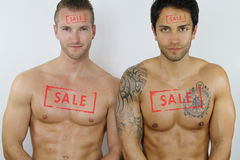 Two sexy men for sale Stock Photography
