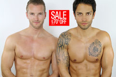 Two sexy men on sale Royalty Free Stock Image