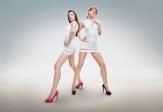 Two sexy nurses. Posing in amazing shoes Stock Photos