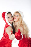Two sexy Santa girls having fun Stock Photos