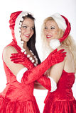 Two sexy Santa girls having fun Stock Photography