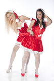 Two sexy Santa girls having fun Stock Images