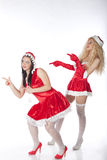 Two sexy Santa girls having fun Royalty Free Stock Photography