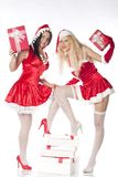 Two sexy Santa girls having fun Stock Photo