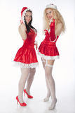 Two sexy Santa girls having fun Royalty Free Stock Image