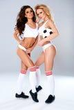 Two sexy seductive female athletes Stock Photos