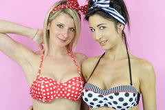 Two sexy women dressed in pin up Stock Photo