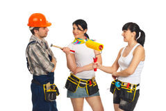 Two women flirting with workman Royalty Free Stock Images