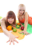 Two women with fruits Royalty Free Stock Photos