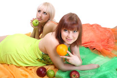 Two women with fruits Royalty Free Stock Images