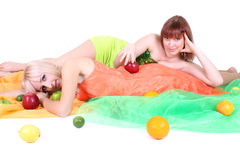 Two women with fruits Royalty Free Stock Photo
