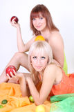 Two sexy women with fruits Stock Photography