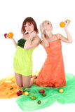 Two sexy women with fruits Stock Photos