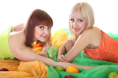 Two sexy women with fruits Royalty Free Stock Images