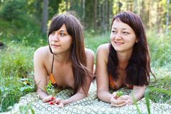 Two sexy women in grass Royalty Free Stock Images