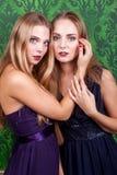 Two sexy women in green retro vintage interior Stock Photo