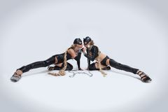 Two women in latex costumes and cat masks Royalty Free Stock Photography