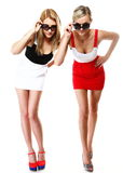 Two sexy women wearing mini skirts Stock Images
