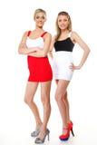 Two sexy women wearing mini skirts Stock Photo