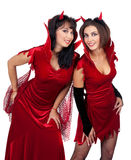 Two Sexy Young Women in Halloween costumes of Devils Royalty Free Stock Photos