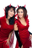 Two Sexy Young Women in Halloween costumes of Devils Royalty Free Stock Images