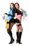 Two sexy young women after shopping Stock Images