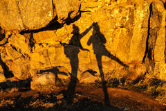 Two shadows of girls on a stone wall in Thingvellir national par Stock Photo