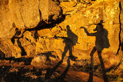 Two shadows of girls on a stone wall in Thingvellir national par Royalty Free Stock Images