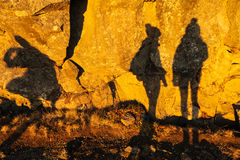 Two shadows of girls on stone wall in Thingvellir national park Stock Images