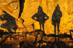 Two shadows of girls on stone wall in Thingvellir national park Stock Image