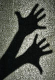 Two shadows hands Royalty Free Stock Images
