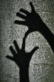 Two shadows hands Stock Photography