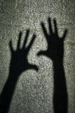 Two shadows hands Royalty Free Stock Image