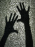 Two shadows hands Royalty Free Stock Photography